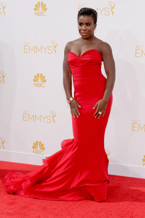 LOS ANGELES, CA - AUGUST 25: 66th ANNUAL PRIMETIME EMMY AWARDS -- Pictured: Actress Uzo Aduba arrives to the 66th Annual Primetime Emmy Awards held at the Nokia Theater on August 25, 2014. (Photo by Kevork Djansezian/NBC/NBC via Getty Images)