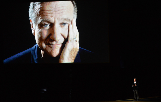 Billy Crystal speaks in tribute to the late Robin Williams onstage at the 66th Annual Primetime Emmy Awards