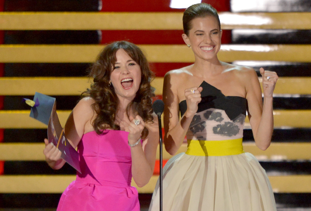 Zooey Deschanel and Allison Williams speak onstage at the 66th Annual Primetime Emmy Awards