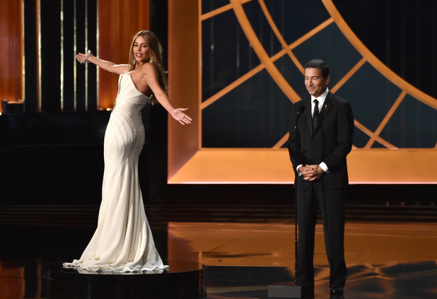 Sofia Vergara and Television Academy CEO Bruce Rosenblum speak onstage at the 66th Annual Primetime Emmy Awards