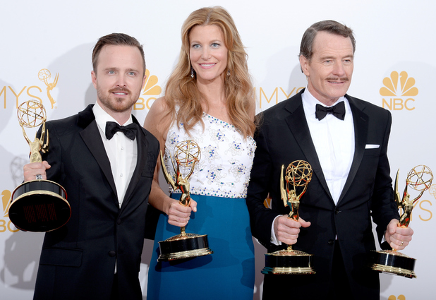Aaron Paul, Anna Gunn, and Bryan Cranston, winners of Outstanding Drama Series for Breaking Bad pose in the press room during the 66th Annual Primetime Emmy Awards