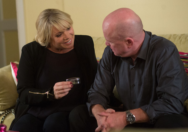 Sharon gives Phil a gift of cufflinks