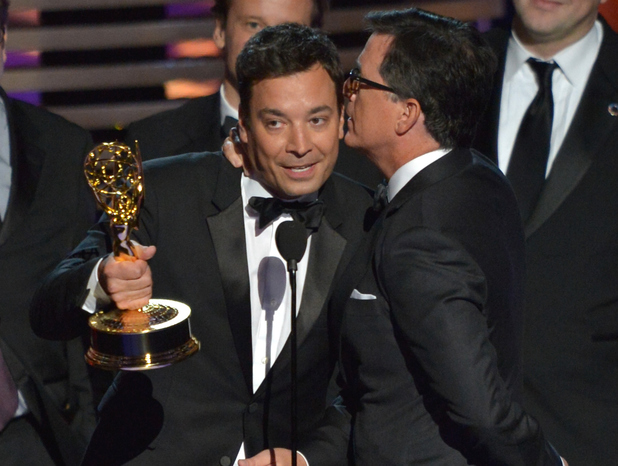 Jimmy Fallon and Stephen Colbert speak onstage at the 66th Annual Primetime Emmy Awards