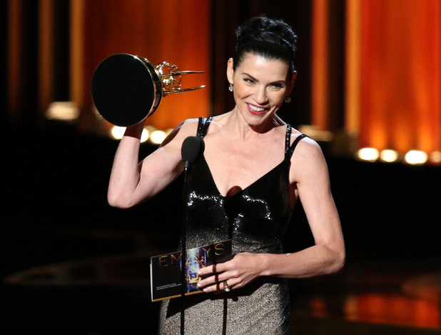 Julianna Margulies accepts the Outstanding Lead Actress in a Drama Series award for The Good Wife on stage during the 66th Annual Primetime Emmy Awards