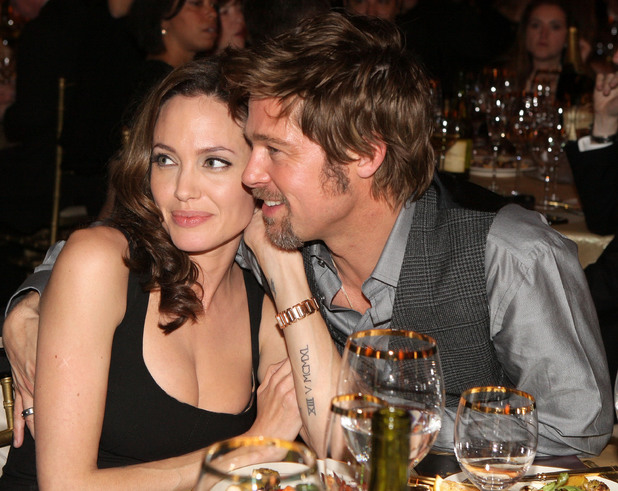 SANTA MONICA, CA - JANUARY 07: Actress Angelina Jolie and actor Brad Pitt sit together inside at the 13th ANNUAL CRITICS' CHOICE AWARDS at the Santa Monica Civic Auditorium on January 7, 2008 in Santa Monica, California. (Photo by Chris Polk/WireImage)