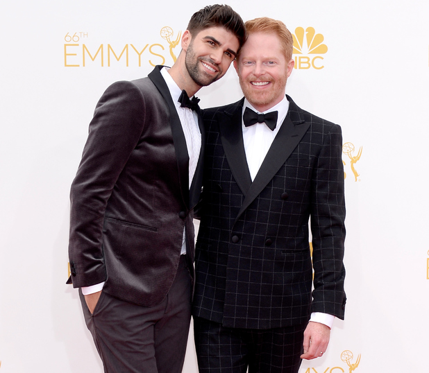 LOS ANGELES, CA - AUGUST 25: 66th ANNUAL PRIMETIME EMMY AWARDS -- Pictured: (l-r) Justin Mikita and actor Jesse Tyler Ferguson arrive to the 66th Annual Primetime Emmy Awards held at the Nokia Theater on August 25, 2014. (Photo by Kevork Djansezian/NBC/NBC via Getty Images)