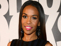 Michelle Williams says that her Destiny's Child bandmate isn't pregnant.