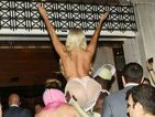 Guess the semi-naked star being carried into her hotel by her dancers