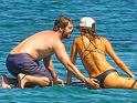 The Hollywood actor couldn't keep his hands off his female companion in Malibu.