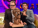 Alan Carr makes a clay head of the 'Hello' singer with his eyes closed.