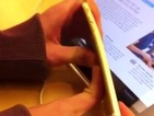 Two teenagers post a video of themselves bending the new smartphones at an Apple Store.