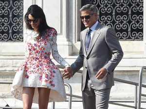 VENICE, ITALY - SEPTEMBER 28: George Clooney and Amal Alamuddin leave the Aman Hotel on September 28, 2014 in Venice, Italy. George Clooney is set to marry his lawyer fiancee Amal Alamuddin this weekend in Venice where they met. (Photo by PVS/GC Images)