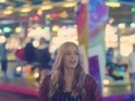 The singer goes exploring around a fairground.