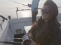 See Katie Price go fishing for charity