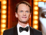 Neil Patrick Harris accepts the award for Best Performance by an Actor in a Leading Role in a Musical for Hedwig and the Angry Inch onstage during the 68th Annual Tony Awards