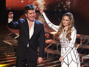 Simon Cowell & Cheryl Cole on stage during The X Factor week 2 results show