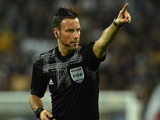 Referee Mark Clattenburg of Great Britain signals a foul durig the UEFA Europa League semi final match between Juventus and SL Benfica