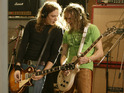 Dan and Justin Hawkins of The Darkness recording guitar parts for the Band Aid 20 charity single, 'Do They Know It's Christmas'