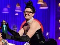 Alan Carr tries to land some champagne into a glass stuck to his fake bum.