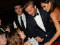David Beckham mingles with Mulligan at bash