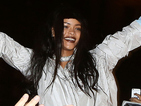 Rihanna crowd surfs during video shoot in Paris