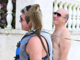 Lauren Silverman is pictured at the beach with son Eric while on break in Barbados with Simon. Simon and Lauren are vacationing with hypnotist Paul McKenna and his finance, as well as Sinitta and friends.