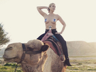 Chelsea Handler goes topless on a camel for Middle East peace