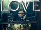 Kim Kardashian West poses in a phone box with a burger for Love magazine