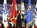 The duo open Super Bowl XLIX in Arizona with patriotic anthems.