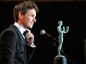Eddie Redmayne speaks onstage during TNT's 21st Annual Screen Actors Guild Awards