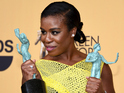 Uzo Aduba posesin the press room at the 21st Annual Screen Actors Guild Awards