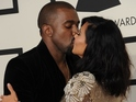 The couple kiss for the cameras at the Grammys.