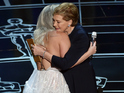 The singer is hugged and congratulated after performance by original star Julie Andrews.