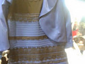A special white and gold version of 'that dress' will be auctioned for charity.