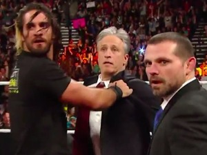 Jon Stewart in the WWE ring with Seth Rollins