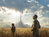 George Clooney stands before a shimmering city in new Tomorrowland poster