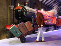 Mark Williams pushes the luggage trolley on Platform 9 3/4 at the Warner Bros. Studio Tour London
