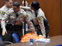 Suge Knight faints in court as $25m bail set