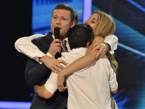 Dermot O'Leary with Olly Murs, Stacey Solomon and Joe McElderry on the X Factor 2009