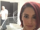 Singer captures her father Gary in the background of new photo showing off her bright red bob.