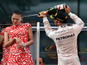 F1 model shrugs off champagne spray