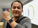 Yuichiro Masui, the first Apple Watch customer at a telecom shop in Tokyo's Omotesando area, poses with his new watch on April 24, 2015