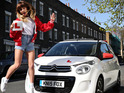 The singer-songwriter gets behind the wheel of a Citroën for charity.