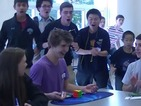 Teenager breaks Rubik's Cube record in 5.25 seconds and the crowd goes wild