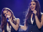 Watch the Bellas sing 'Cups' around the campfire in Pitch Perfect 2