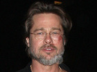 Brad Pitt reveals nasty gash on his face from running up the stairs in the dark