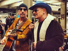 U2 surprise commuters in New York City with performance on the subway