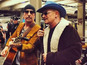 U2 surprise commuters on NYC subway