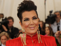 The Jenner/Kardashian matriarch makes a bold impact in a striking red outfit.