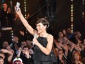 Emma Willis marks off the contestants who have gone.